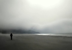 Beach, sea mist, the figure of a man